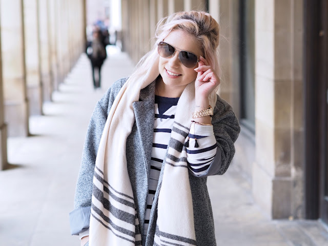 grey coat and sunglasses
