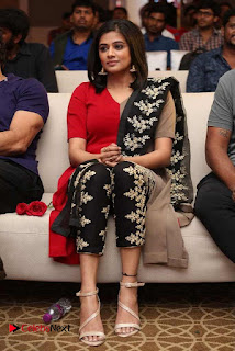 Priyamani Pictures in Red Salwar Kameez at Mana Oori Ramayanam Audio Launch 0004