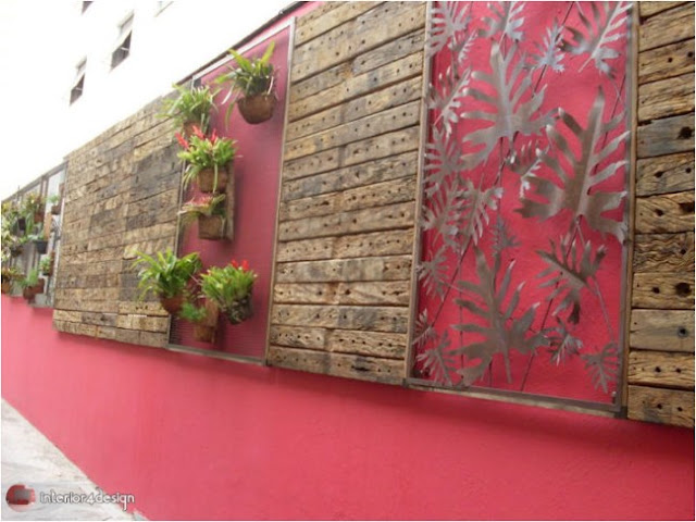 Red wall with plant and wood