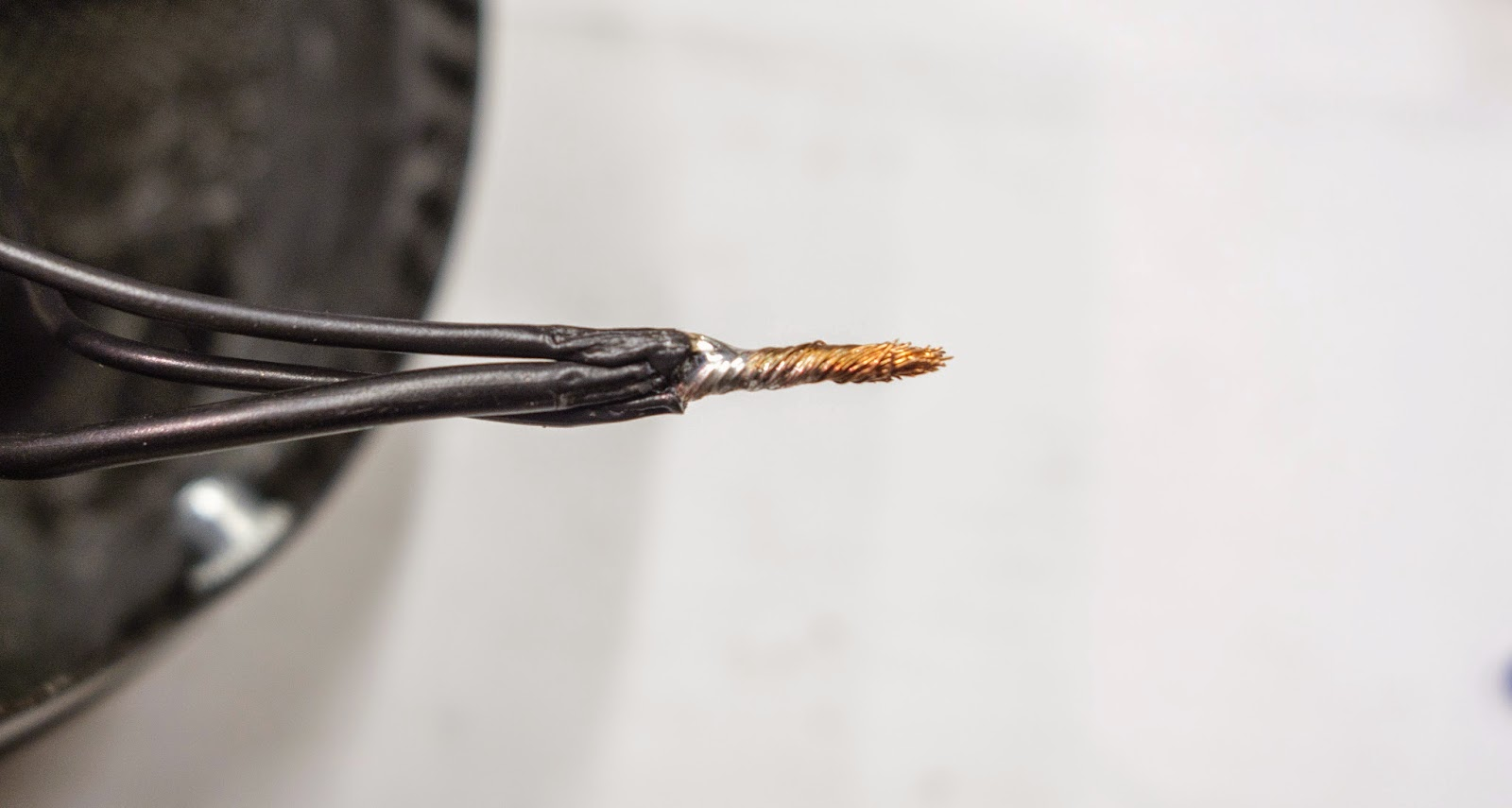 Three earth wires twisted and lightly soldered to form a good connection