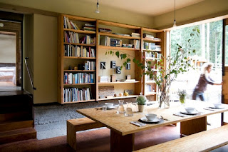 Fascinating Wooden Bookshelves near the Wooden Dining Sets With Benches in Simple Style on Brown Floor