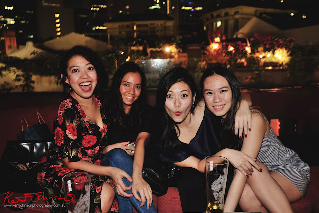 A group of friends enjoying a night out at Screening Room Rooftop Bar, Singapore. Photo by Kent Johnson for Street Fashion Sydney.
