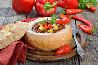 Hungarian goulash soup in a loaf