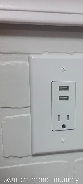 faux fake brick paneling made from wood! also love the USB/power outlet combo. Basement renovation update for a home sewing studio and home office. || Sew at Home Mummy