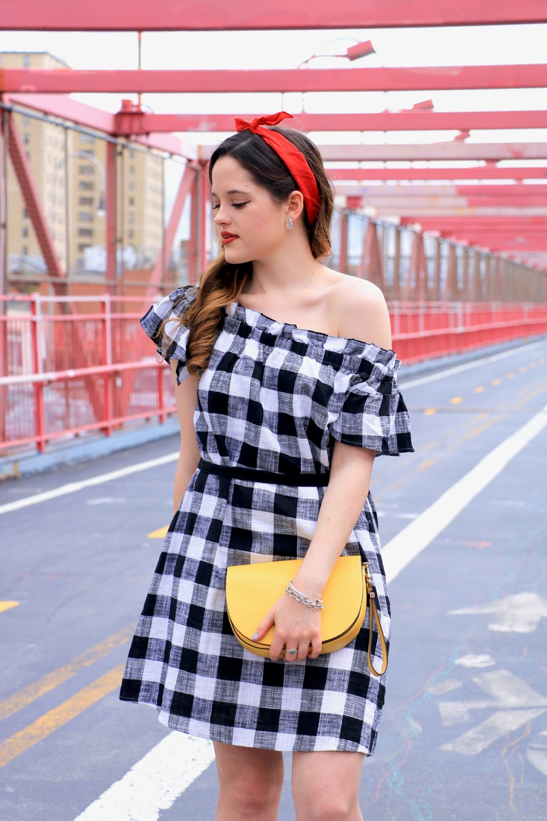 New York fashion blogger Kathleen Harper on the Williamsburg Bridge in gingham dress