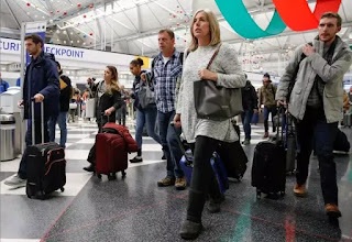 Storm strands US holiday travelers, more than 1,240 flights canceled