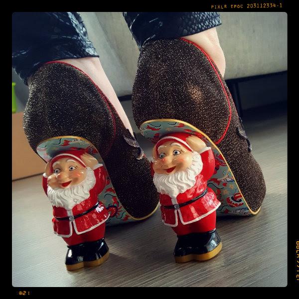 wearing irregular choice santa's ninth character heel detail