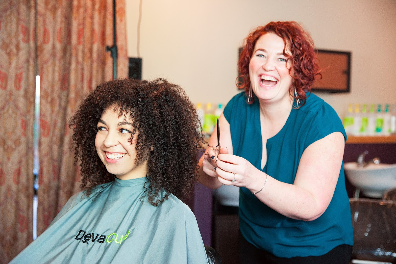 girl receiving natural curly hair cut