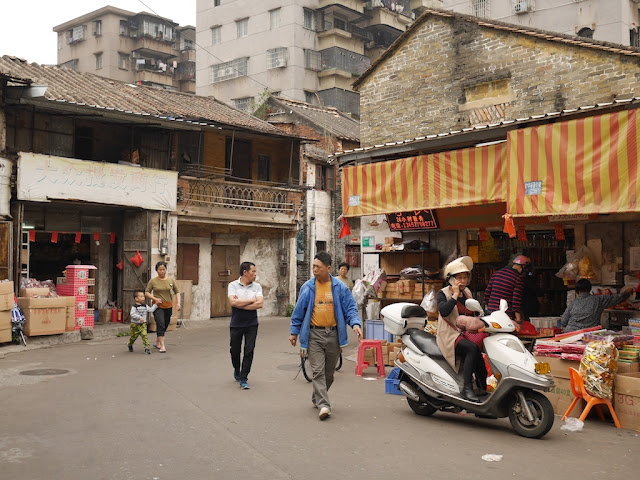 people walking on Baisha Road in Jiangmen