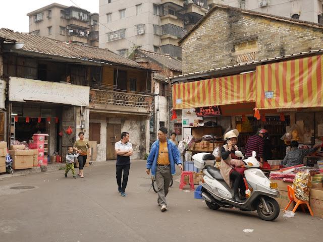 people walking on Baisha Road in Jiangmen