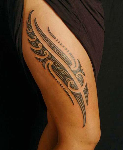 kadın üst bacak tribal dövme woman thigh tribal tattoo