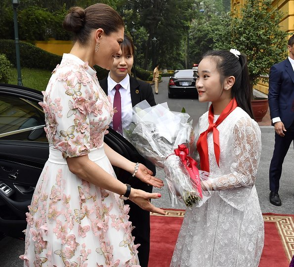 Crown Princess Victoria in Ida Sjostedt govn, Camilla Thulin floral dress and Rodebjer print dress. President Dang Thi Ngoc Thinh
