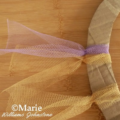 Strips of fabric tied around cardboard