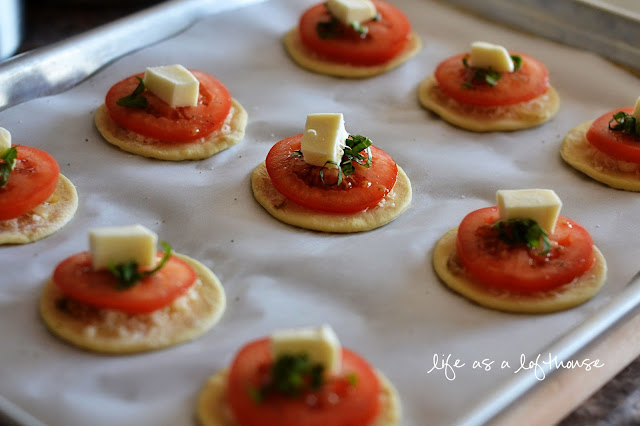 Delicious pastry tarts topped with cheese, tomato, basil and thyme. Life-in-the-Lofthouse.com