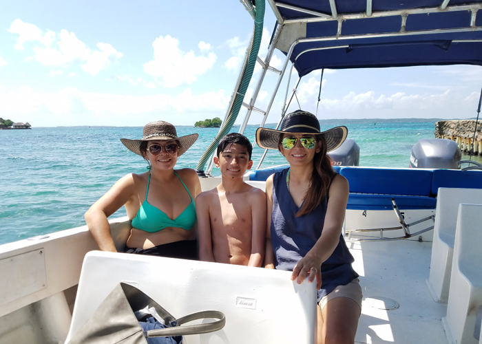 on the boat Cristina Garay, Claudia Herran and Matthew Garay heading off to the corals to snorkeling