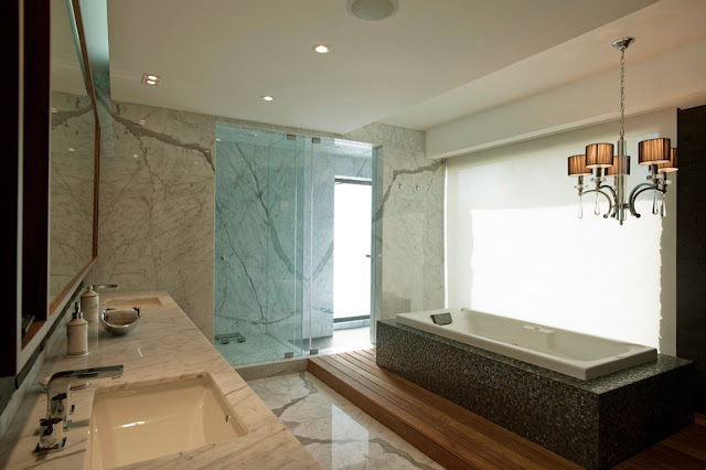 Modern bathroom with white marble walls and bath tub