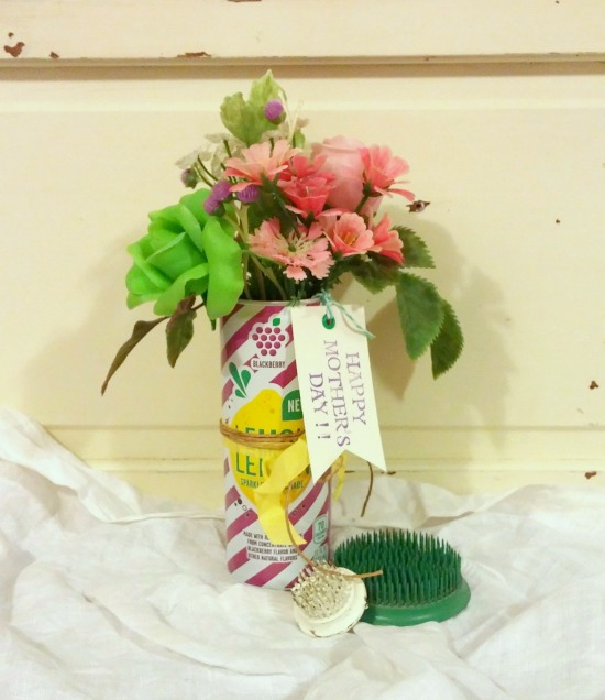 Recycled a colorful can into a useful flower vase