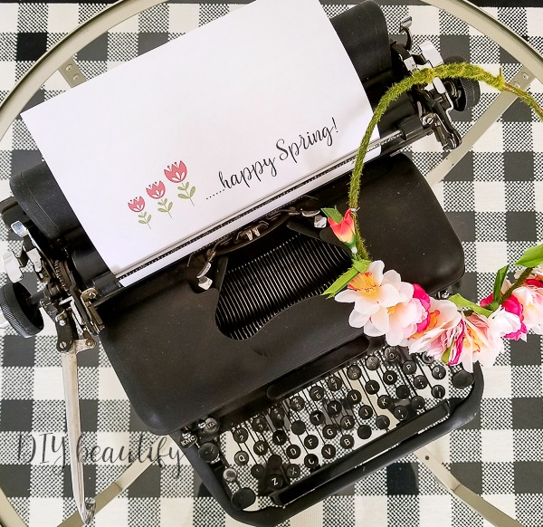 vintage typewriter with spring decor
