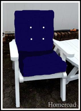 White patio chair with blue cushion