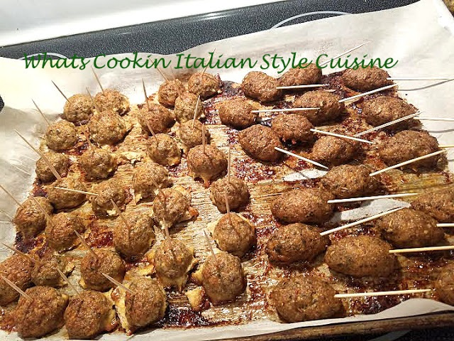 baked meatballs and sausage skewers on a stick