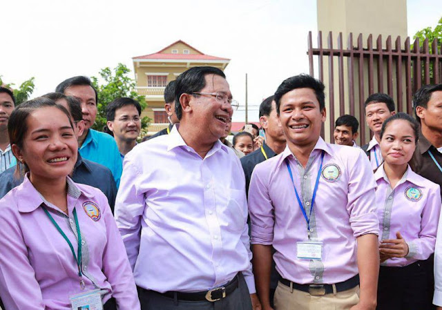 Prime Minister Hun Sen talks to students in Takeo province last week during a provincial tour. Facebook