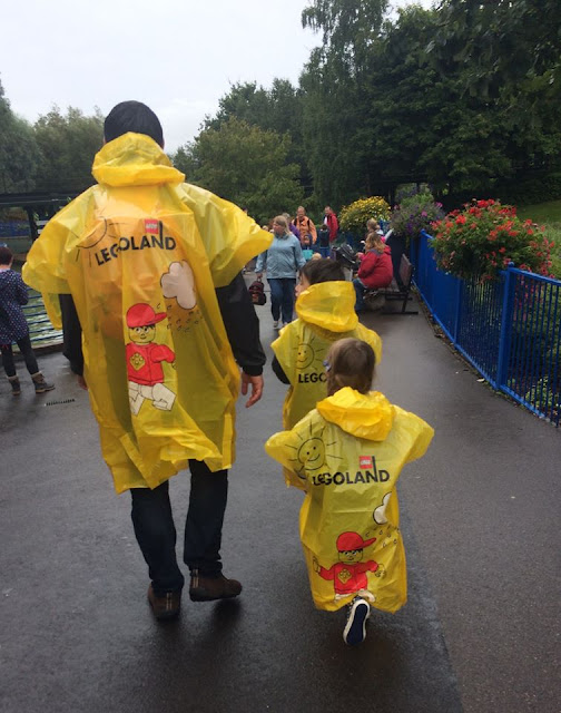 Yellow Legoland Windsor ponchos on a rainy day
