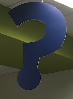 question mark sign over the info desk at KP