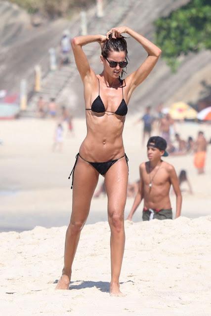 Izabel Goulart in Black Bikini on the beach in Rio
