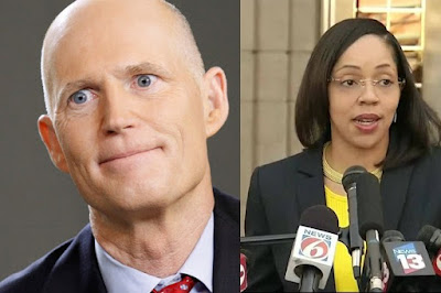 Rick Scott, left, Aramis Ayala