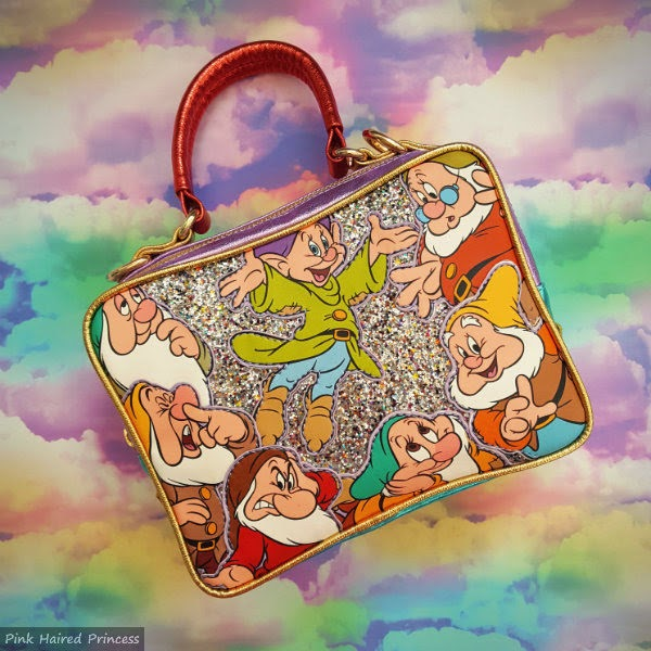 front of glitter handbag with seven dwarfs faces on rainbow background