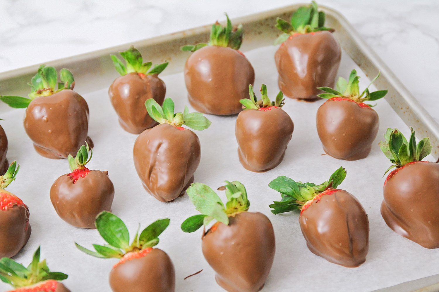 These homemade chocolate covered strawberries are so easy to make and so delicious! They're the perfect romantic dessert for Valentine's Day!