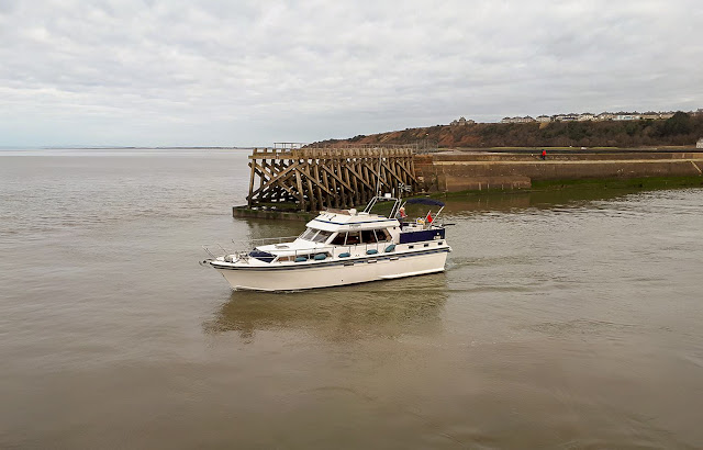 Photo of Ravensdale passing the end of the old pier on the way out of Maryport