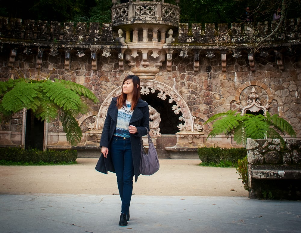 Outfit in front of portal of the guardian Quinta da Regaleira Sintra Portugal