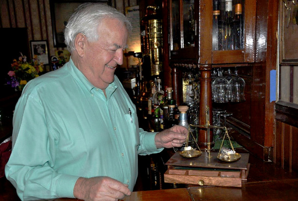 owner Stephen Willey with gold scale at National Hotel in Jamestown, California