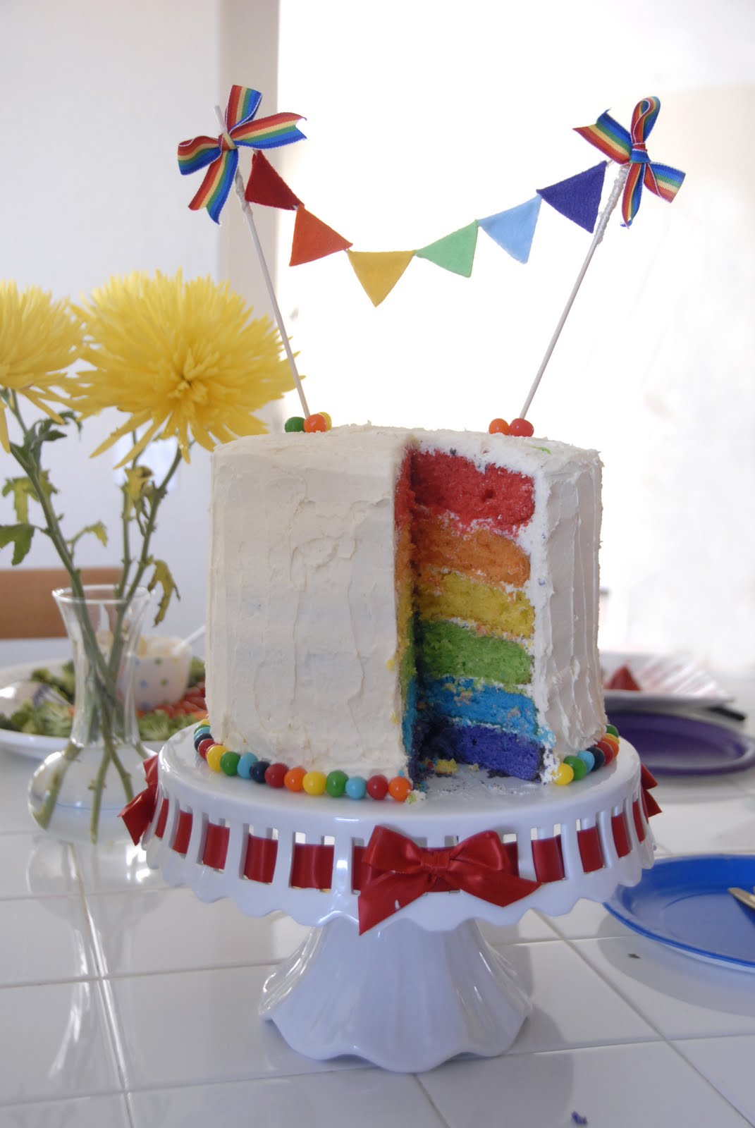 I Made A Simple Pennant Bunting By Gluing Colored Felt To Twine And Lined The Bottom Of Cake With Chewy Lemonheads In Rainbow Order