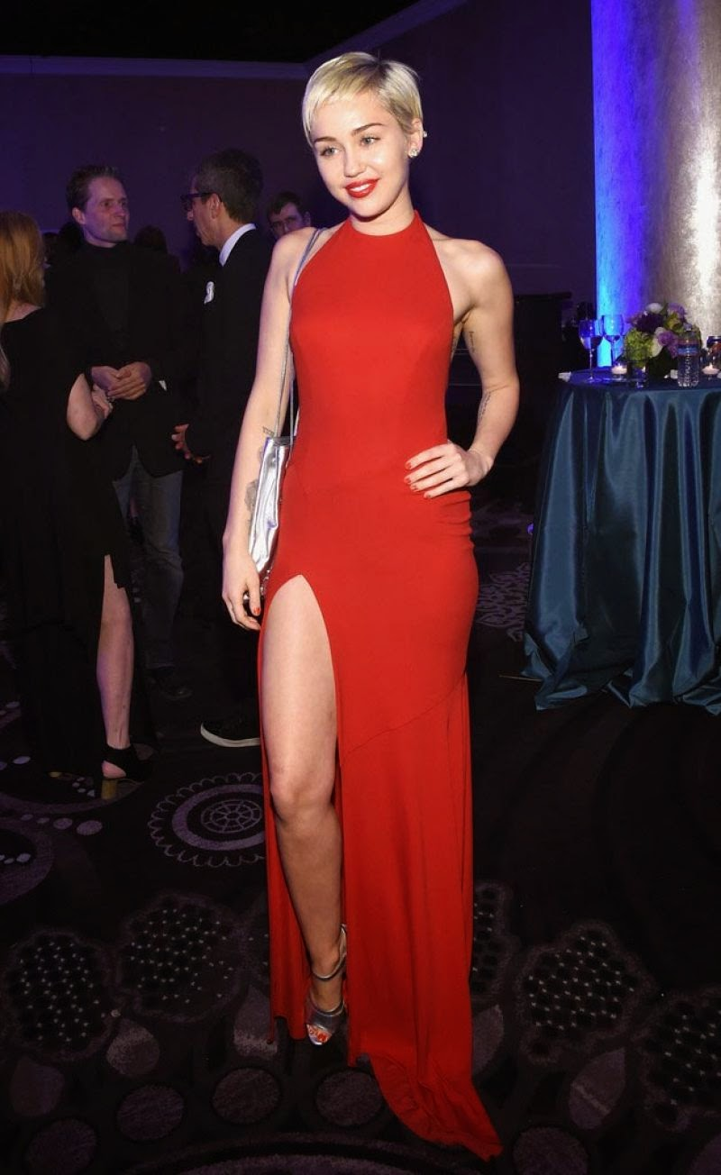Miley Cyrus looks red hot in a thigh-slit dress at the Annual Clive Davis Pre-Grammys Gala in Beverly Hills