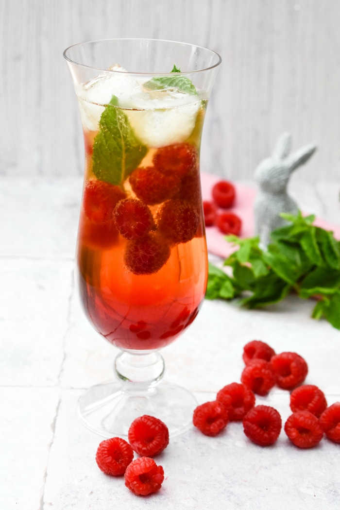 A tall glass of Scottish Raspberry & Mint Cider Cooler
