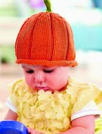 http://www.letsknit.co.uk/free-knitting-patterns/halloween-baby-hat-and-bootees