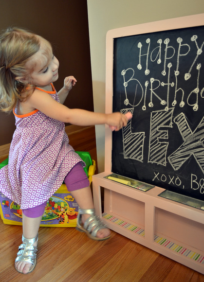 Les loves to draw on her new chalkboard and I'm so glad we decided to clean it up and spray paint it for her!