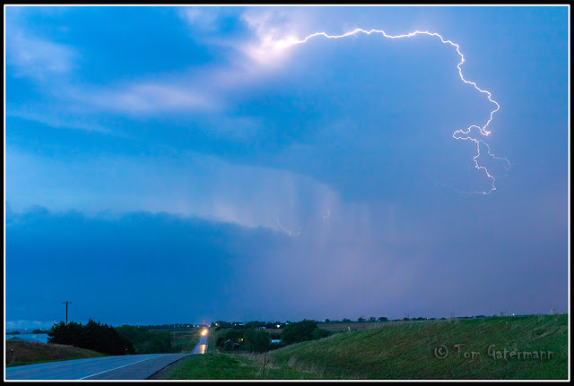 A lightning bolt arcs out across the Nebraska sky