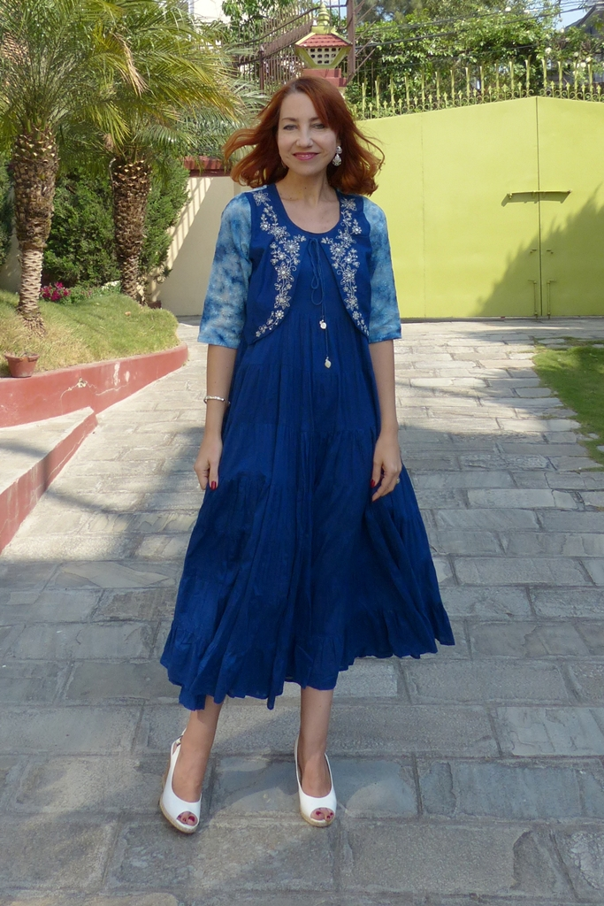 Blue maxi dress with embroidered top over it from Biba