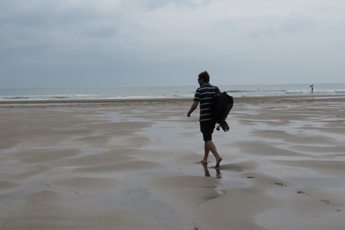 Simon walking on Croyde Bay beach, North Devon