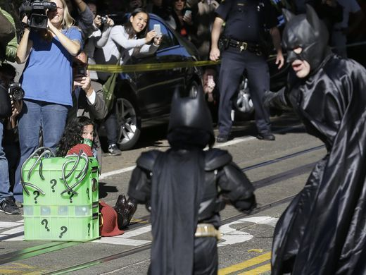 For a single day, San Francisco became the Gotham of comic books as thousands of people took a break from their jobs and came on to the streets to support the Batkid, Miles Scott