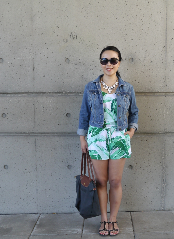 Summer weekend style: palm print romper, denim jacket, white statement necklace. oversize sunnies