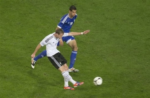 Germany forward André Schürrle shoots the ball to score against Israel