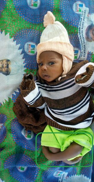 baby boy wrapped buhari campaign ankara