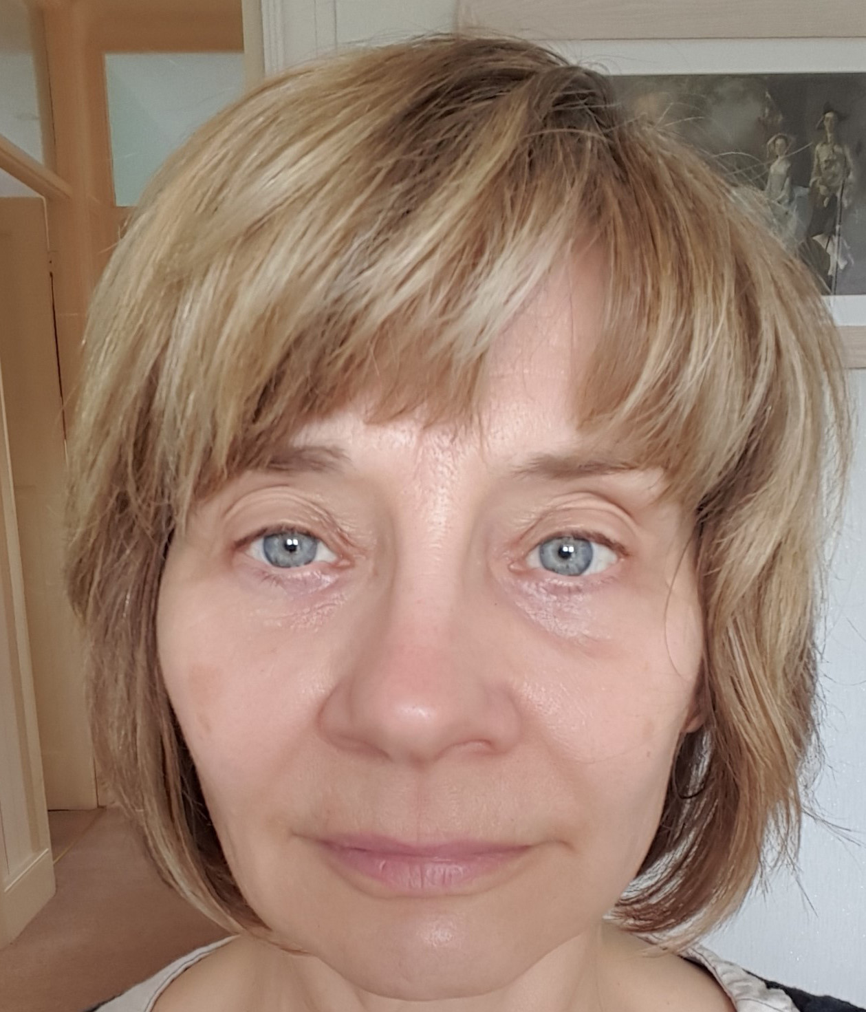 "The ""before"" shot showing an over 40s woman who isn't wearing makeup"