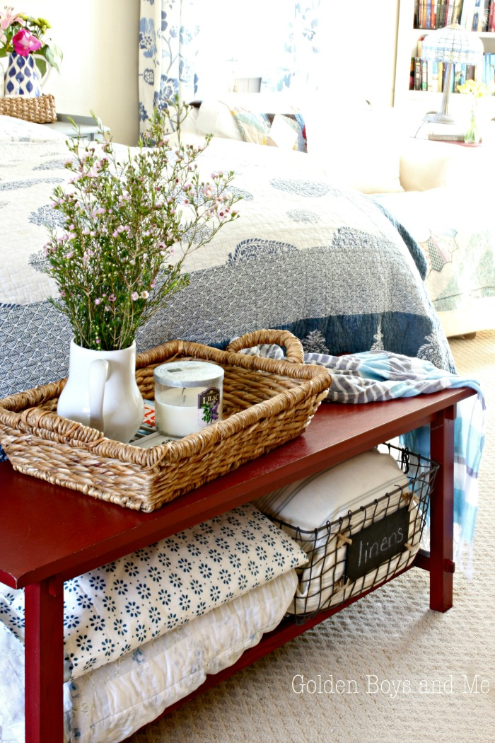 Bench at bottom of bed with blue and white decor - www.goldenboysandme.com