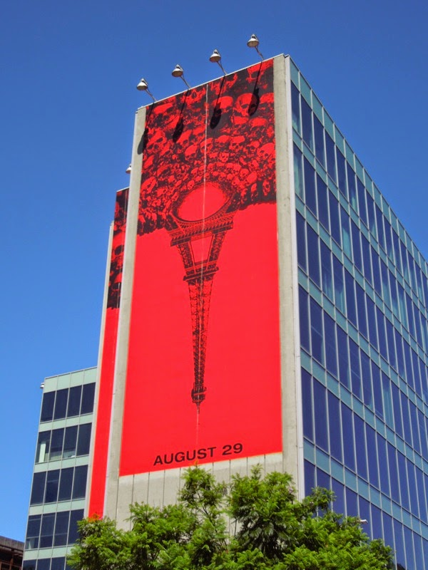 Giant As Above So Below inverted Eiffel Tower billboard