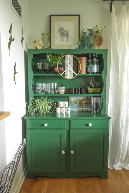 green hutch with glass knobs